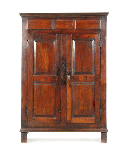 A small oak press cupboard 18th century and later