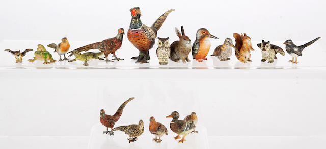 A collection of eighteen cold painted bronze birds and other animals,