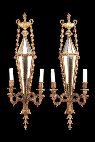 A pair of Italian early 20th century giltwood twin-branch wall lights