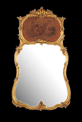 A French early 20th century giltwood trumeau mirror in the Louis XV style