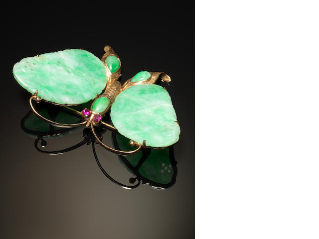 A gold mounted jadeite brooch designed as a butterfly