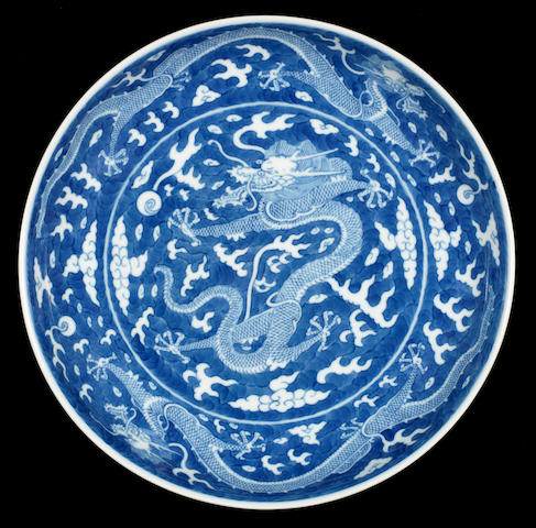 A blue and white 'dragon' dish Tongzhi six-character mark and of the period