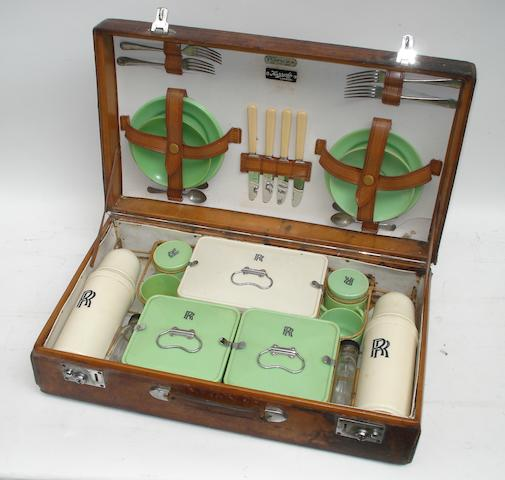 A leather-cased 'Coracle' four-person picnic set for Rolls-Royce,