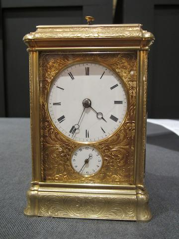 A good, small, third quarter of the 19th century French engraved brass bell-striking and repeating carriage clock with alarm