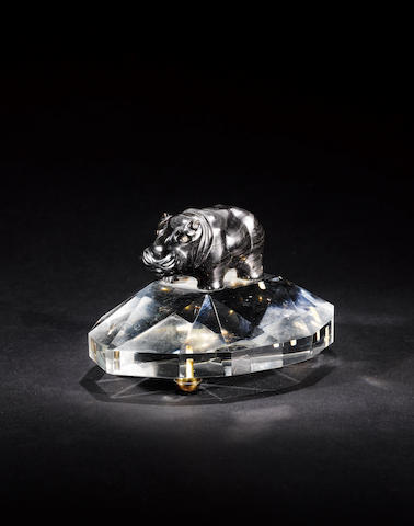 A dark grey/black hardstone model of a Hippopotamus with diamond eyes