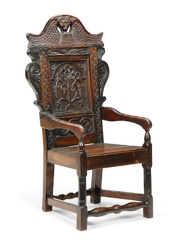 An oak panel back open armchair Parts early 17th century