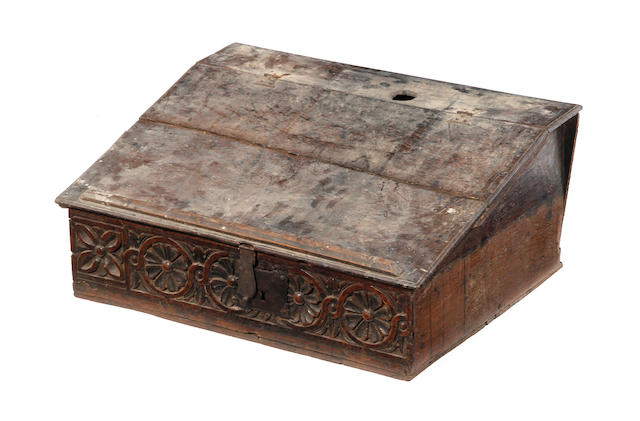 A mid-17th century oak boarded oak desk box