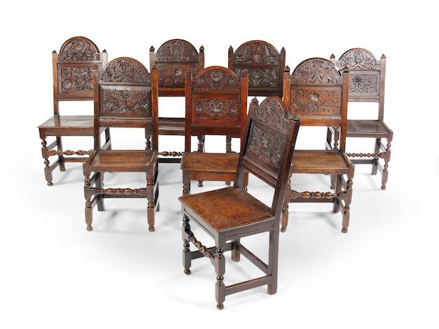 A harlequin set of eight Charles II oak backstools Southern Lancashire/North Cheshire, circa 1680