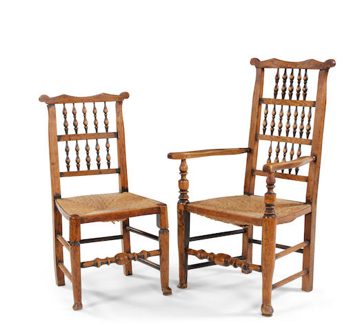 A near set of seven ash eared spindle back chairs Including one open armchair