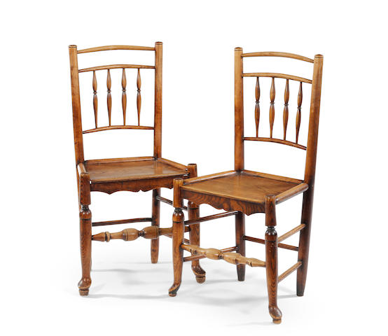 A near set of twelve early 19th century ash spindle back chairs In the manner of the Clisset family, Herefordshire, circa 1820-60