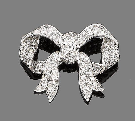 A gold and diamond bow brooch,