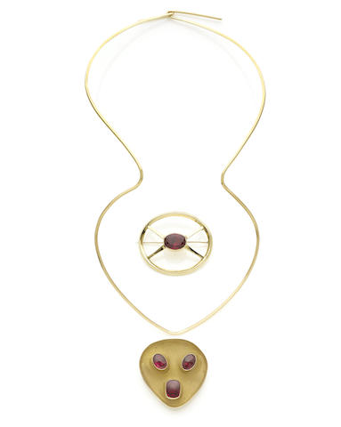 A pair of gold and synthetic ruby pendant/brooches and a torque necklace (3) (illustrated inside the back cover)