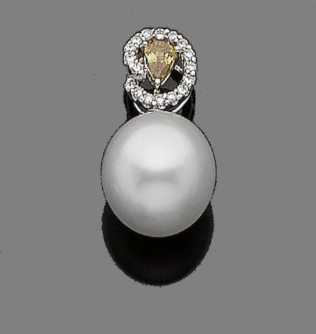 A cultured pearl and diamond pendant