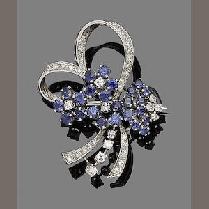 A sapphire and diamond ribbon brooch