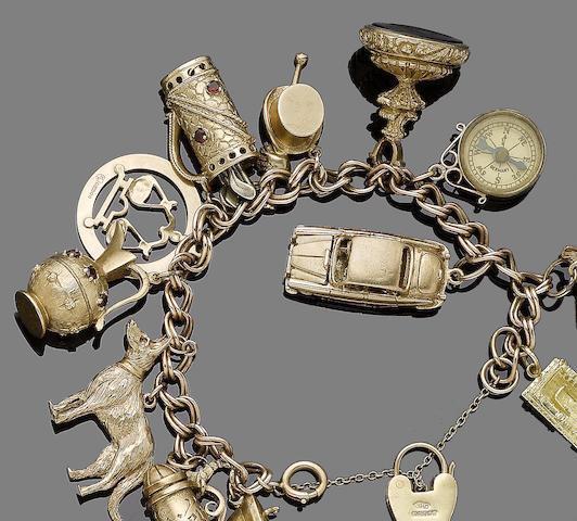 A gold and gem-set charm bracelet