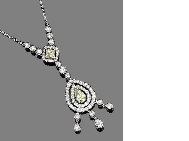 A coloured  diamond and diamond pendant necklace