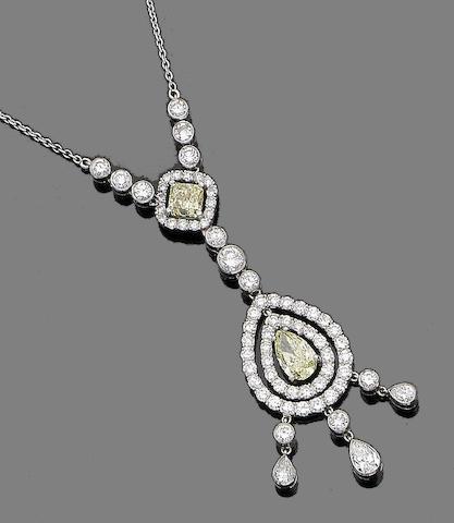 A coloured  diamond and diamond pendant necklace