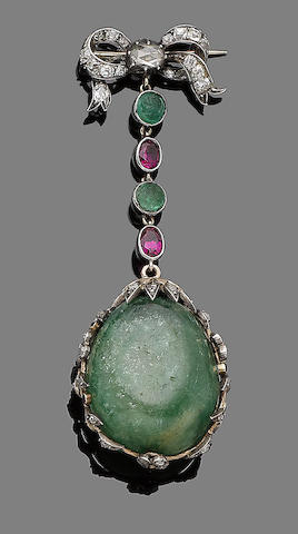 An emerald and synthetic ruby brooch