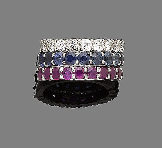 A ruby half-hoop ring, a sapphire half-hoop ring, and a diamond half-hoop ring (3)