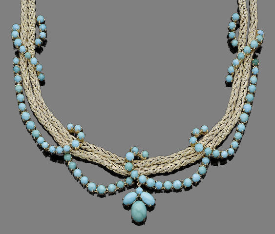 A gold and turquoise necklace