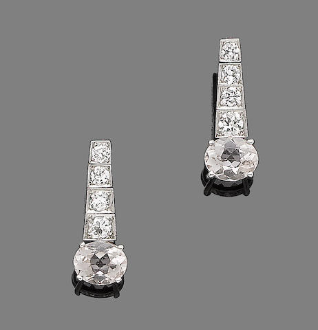A pair of morganite and diamond earrings
