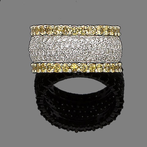A yellow sapphire and diamond eternity ring