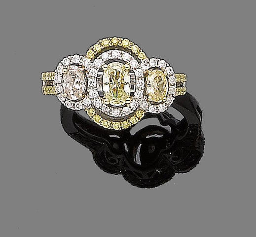 A yellow sapphire and diamond dress ring