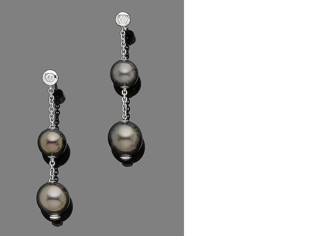 A pair of cultured pearl and diamond earrings, by Mikimoto