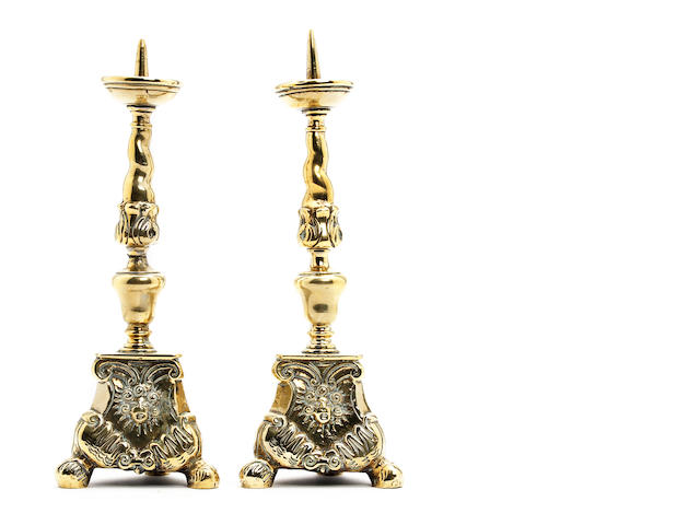 A pair of small brass pricket candlesticks, in the Baroque manner