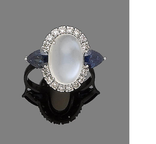 A moonstone, sapphire and diamond ring