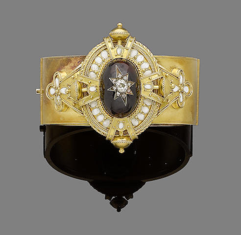 A gold, garnet, enamel and diamond bangle,