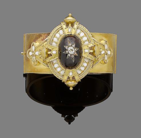 A gold, garnet, enamel and diamond bangle,