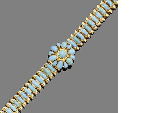 A gold and turquoise bracelet,