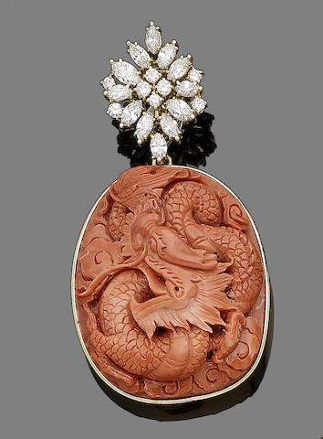 A carved coral and diamond pendant