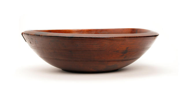 A large 19th century elm dairy bowl