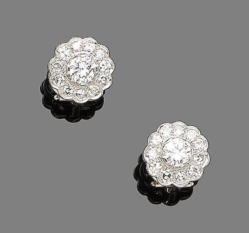 A pair of diamond cluster earclips