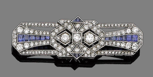 A sapphire and diamond brooch,