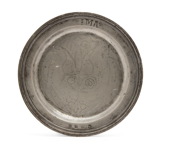 A Charles II/James II pewter multi-reed wriggle-work plate