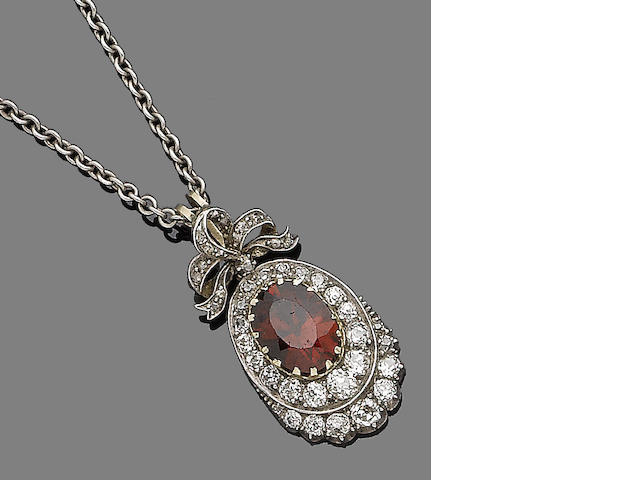 A grossular garnet and diamond pendant necklace,