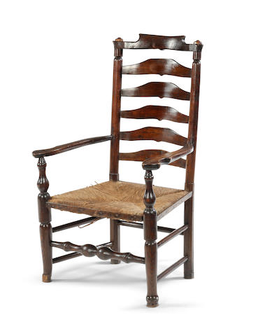 A 19th Century ashwood ladder back elbow chair, North West England, Billing Wigan area