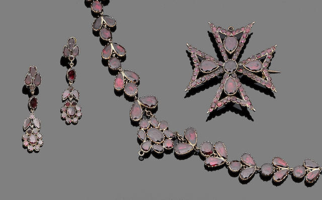 A 19th century garnet rivière, pendent earring and brooch suite (3)