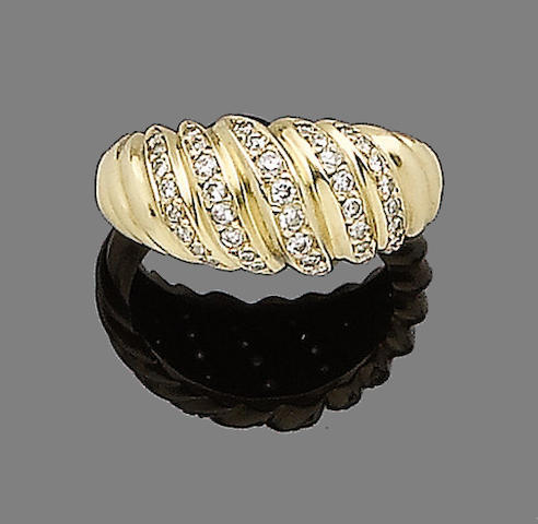 A gold and diamond dress ring, by Cartier