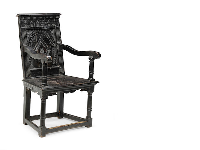 An early 17th century and later sycamore open armchair Later painted, West Country