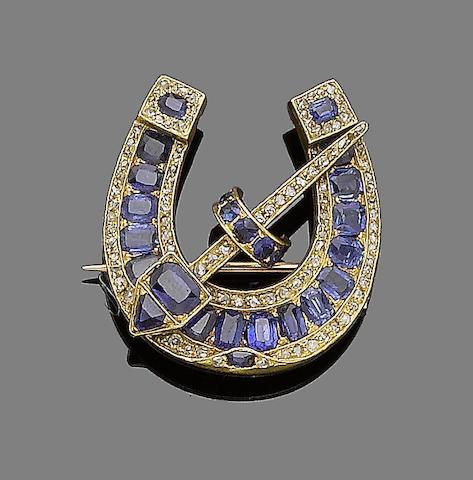 A sapphire and diamond horseshoe brooch,
