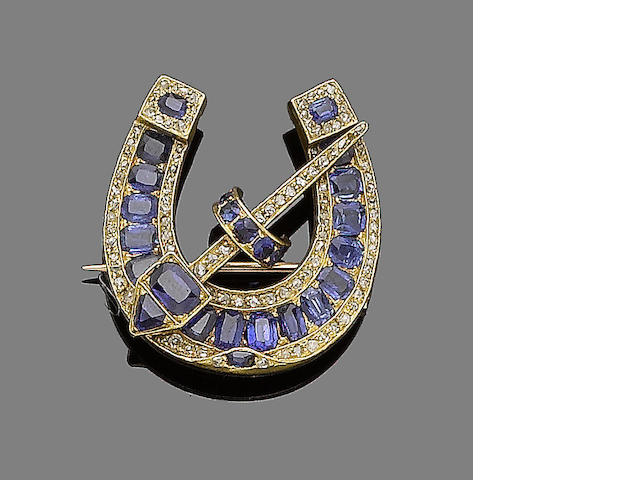 A sapphire and diamond horseshoe brooch,