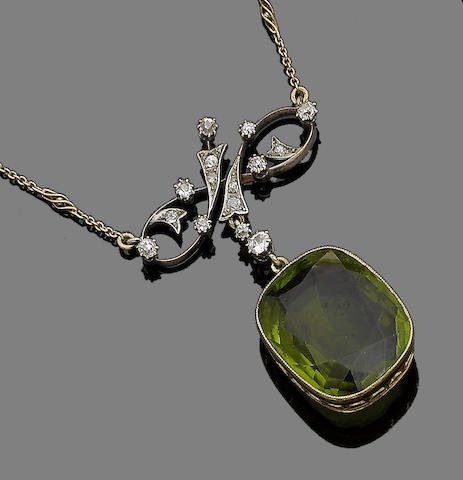 A peridot and diamond pendant necklace