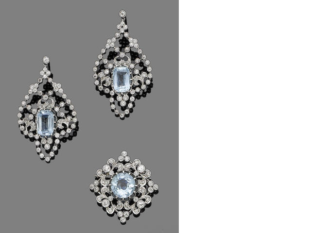 An aquamarine and diamond brooch and pendent earring suite (2)