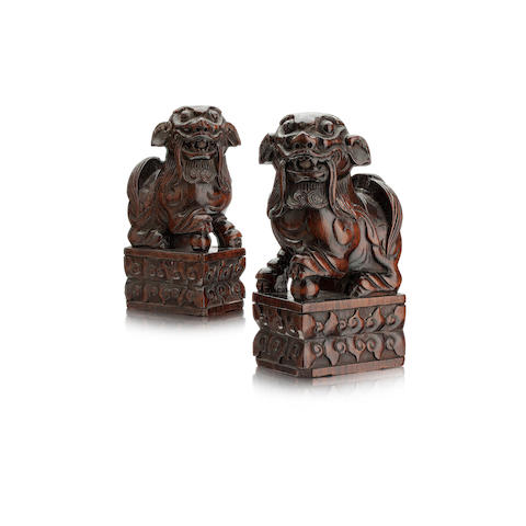 A pair of wooden lion dogs