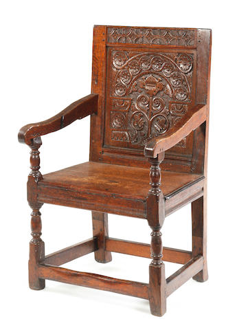 An oak panel back open armchair Part late 17th century