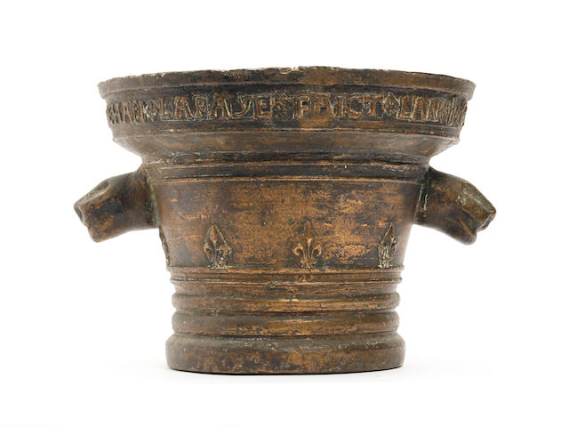A large bronze mortar, dated 1627Probably French